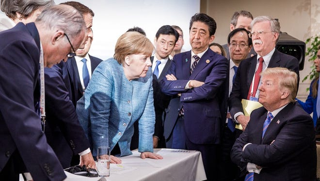 Photo released on Twitter by the German Governments spokesman Steffen Seibert on June 9 and taken by the German government's photographer Jesco Denzel shows President Trump talking with German Chancellor Angela Merkel and surrounded by other G7 leaders during a meeting of the G7 Summit in La Malbaie, Quebec, Canada.