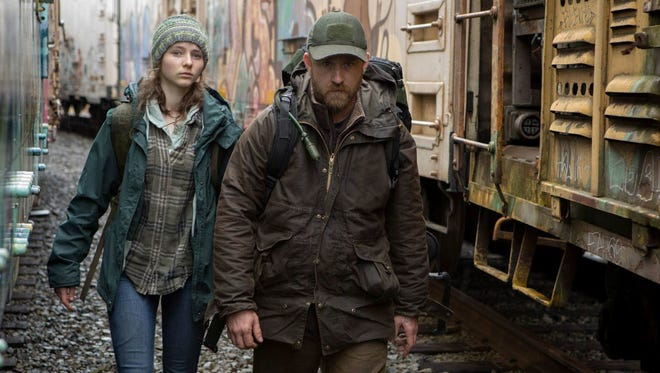 """Thomasin McKenzie (left) and Ben Foster (right) in """"Leave No Trace."""""""