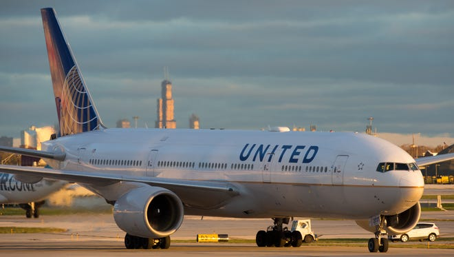 A United Airlines Boeing 777-200 taxis for departure from Chicago O'Hare International Airport in November 2016.
