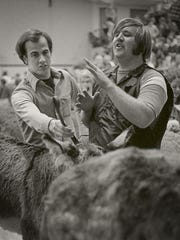 Rich Perlberg, left, and Lee Shelander work to wrangle their respective animals during a donkey basketball game in the mid-1970s. Shelander was known for his hard work, ready laugh and his passion for Michigan State sports.