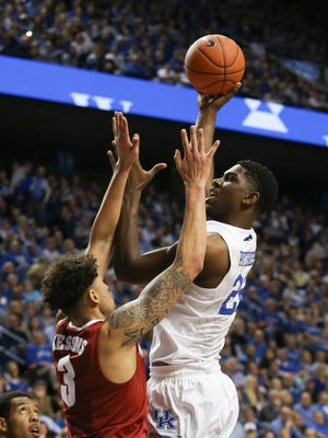UK's Alex Poythress, #22, shoots against Alabama's Michael Kessens, #3, during their game at Rupp Arena.