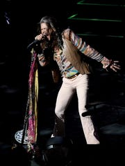 """Singer Steven Tyler performs during his """"Out on a Limb"""""""