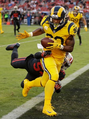 Rams running back Todd Gurley scores a touchdown while being tackled by 49ers linebacker Ray-Ray Armstrong during the first half of Thursday night's game in San Francisco.