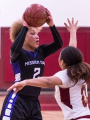 Mission Oak's Kambrayia Elzy looks to pass against