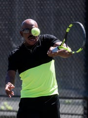 Local tennis pro Linsley McMillion practices Thursday, March 22, 2018, at the Roger Scott Tennis Center in Pensacola.