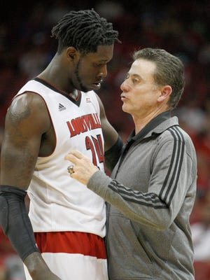 Montrezl Harrell talks with coach Rick Pitino during the scrimmage.October 26, 2014