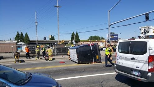 Salem Fire Department respond to the scene of an armored vehicle that rolled after a crash on Silverton Road and Fisher Road on Wednesday, July 26, 2017.