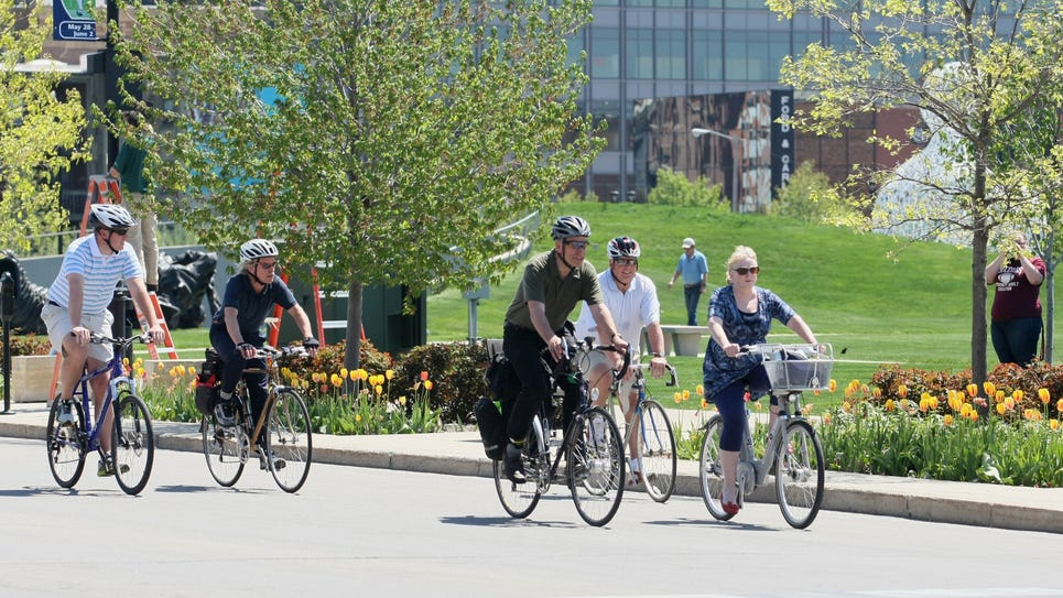 Bicyclists ride through Des Moines streets in May 2013.