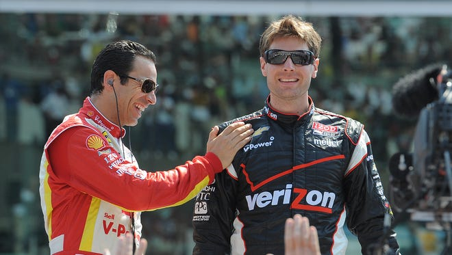 FILE -- Teammatea Helio Castroneves, left, jokes with team mate Will Power,right, before the running of the 96th Indianapolis 500, May 27, 2012, at the Indianapolis Motor Speedway.