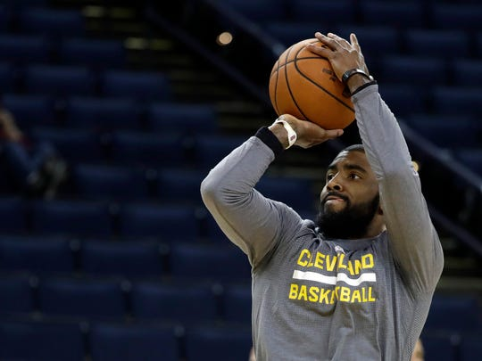 Cleveland Cavaliers' Kyrie Irving shoots during an NBA basketball practice, Wednesday, May 31, 2017, in Oakland, Calif. The Cavaliers face the Golden State Warriors in Game 1 of the NBA Finals on Thursday in Oakland. (AP Photo/Marcio Jose Sanchez)