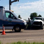 A tractor trailer and a white passenger vehicle were involved in a crash Wednesday morning near Fort Collins.