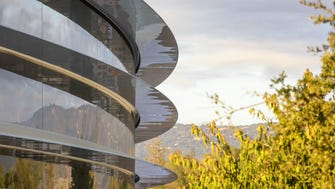 A closeup of the main ring-shaped building at Apple Park.