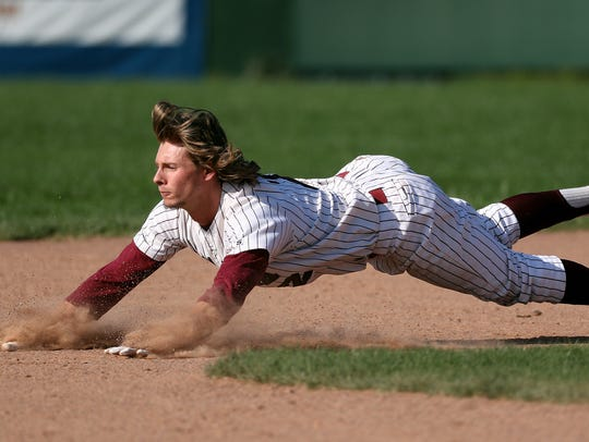 Newark's Ben Cowles slides into second base against