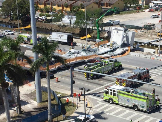 Emergency personnel responds to a collapsed pedestrian