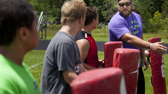 Tim Lelito instructs a group during Lelito's Legacy Camp Tuesday, June 23, 2015 at St. Clair High School.