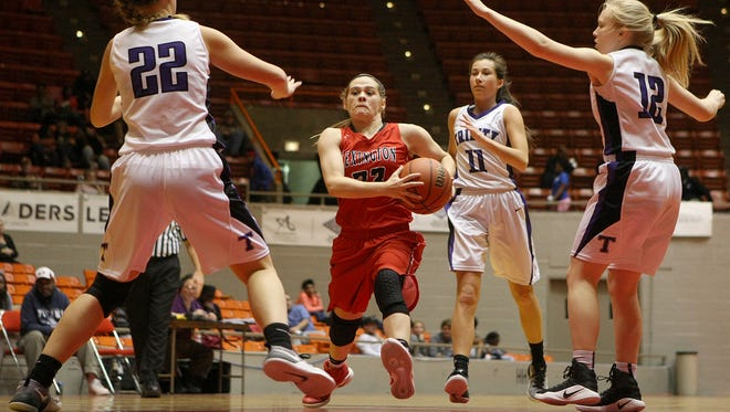 Lexington's Haley Scott (23) drives against Savannah Lee (22), Sally Howell (12) and Trinity Christian Academy during the semifinals of the HUB City Classic at Oman Arena in Jackson on Thursday, Dec. 29, 2016.