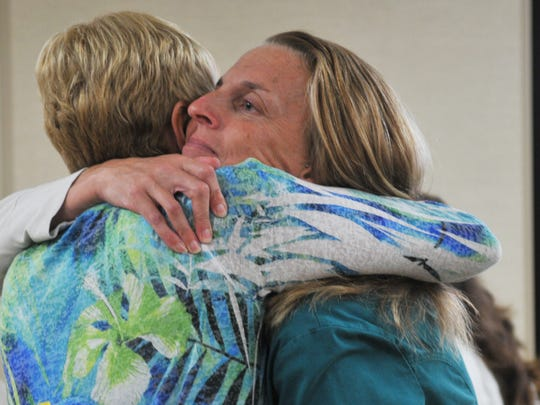 Kelly Almonte, R.N. (face visible) hugs Kathy Taylor, who lost her son, Cory, 26, to heroin addiction. Taylor praised the efforts of nurses and doctors during that painful time. Health First Viera Hospital was one of several gatherings of Health First nurses and other associates  in emotional conversations with Taylor.
