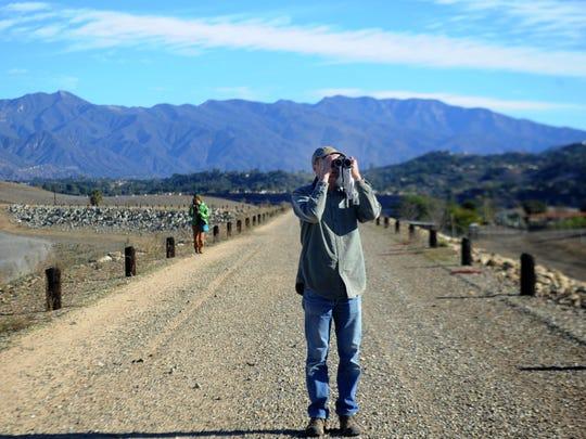 Ken Merideth, of Ventura, counts the birds at Lake Casitas.