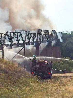"""The """"12-Mile Bridge"""" in Runnels county where County Road 129 crosses the Colorado River burned Sunday, June 18, 2017. Volunteers from the Ballinger VFD responded to the scene."""