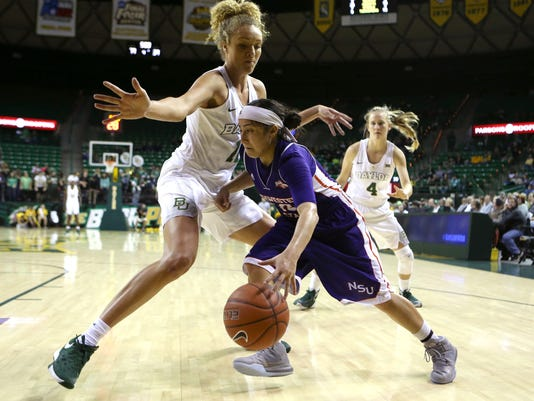Northwestern State guard Jackie Perez (14) drives past Baylor forward Justis Szczepanski (11) in the second half of an NCAA college basketball game, Friday, Dec. 4, 2015, in Waco, Texas. (AP Photo/Jerry Larson)