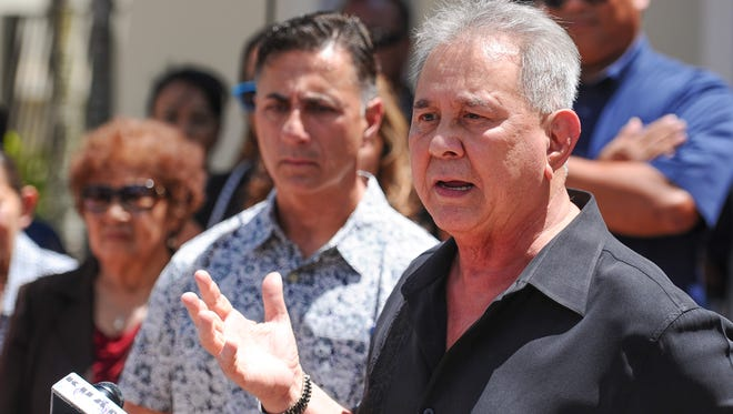 Attorney David Lujan speaks during a press conference outside the Cathedral Pastoral Center in Hagåtña on Tuesday, June 7, 2016. Moments earlier, Walter Denton, 52, seen behind Lujan, announced that he was sexually abused in April 1977, by then-Father Anthony Apuron when he served as an altar boy at the Agat Church. 'I was raped by Anthony Sablan Apuron, who at (this), at that time was a priest at Agat and whom I trusted...,' stated Denton.
