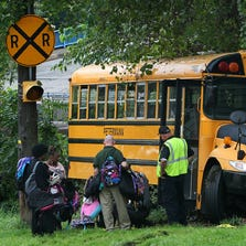 Student book bags are removed from a school bus after a fatal accident in in Akron, Ohio.