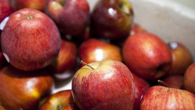 A close-up of fresh red apples in supermarket