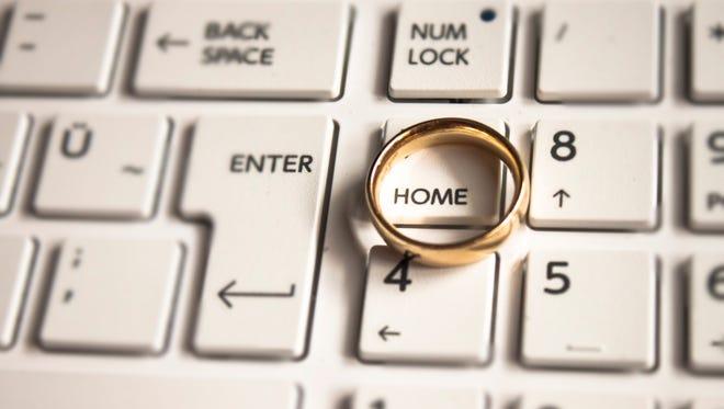 Wedding ring on keyboard keys.