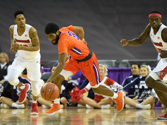 University of Evansville's K.J. Riley (33) goes for a loose ball past Illinois State's Phil Fayne (10) as the University of Evansville plays Illinois State on West Side Day at the Evansville Ford Center Saturday, December 23, 2017.