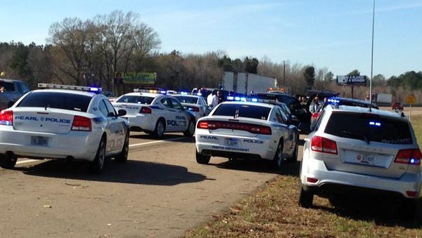 A police chase ends on I-20 in Pearl, Miss.