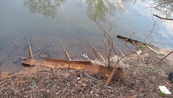 Rusted iron on the drought-exposed lower reaches of Bowmans Inlet off Cross Bayou in Louisiana.
