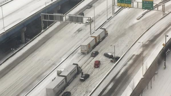 Cars and semis on Fort Washington Way can't make it up the hill to the northbound I-75 or southbound I-71/75 on-ramps without slipping.
