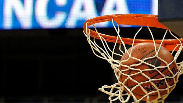 A ball flicks through the net in front of the NCAA logo on the marquis as Middle Tennessee's shoots during NCAA college basketball practice in Pittsburgh,  Saturday, March 20, 2010. Middle Tennessee plays Mississippi State in a first-round game on Sunday. (AP Photo/Keith Srakocic)