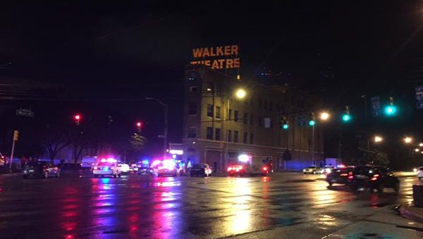 Police respond to reports of at least one person shot near the Walker Theatre Saturday, May 30, 2015.