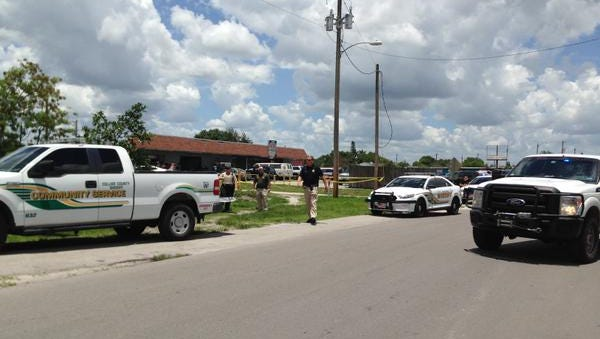 Collier County deputies set up on W. Delaware Street following a shooting involving a deputy Thursday, June 18