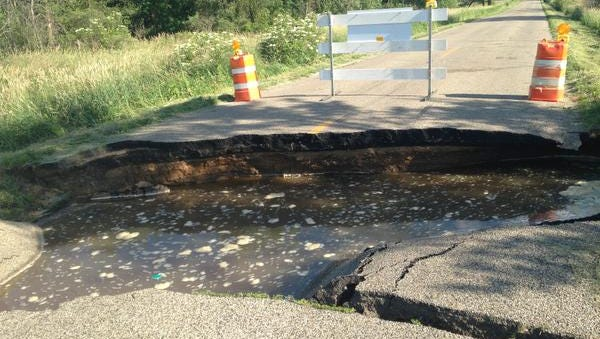 A section of road washed away south of Charlotte on S. Cochran Avenue between Bellevue and Butterfield highways. SHOT TUESDAY JUNE 23, 2015