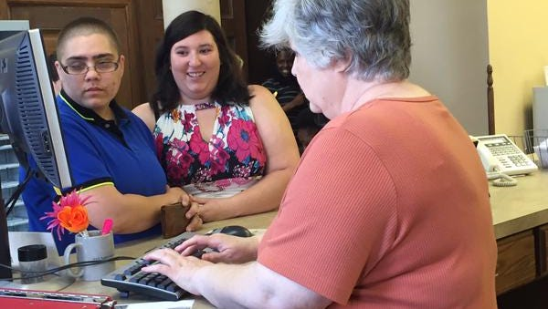Courteney Messenger and Leahy Bloomfield register for their marriage license in Forrest County.