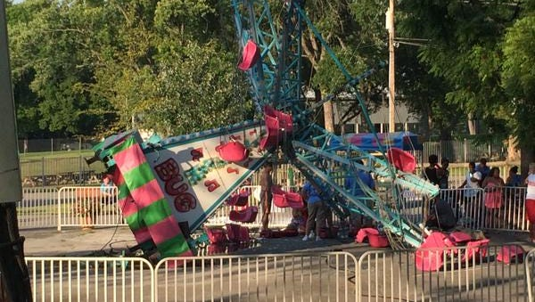 Jitterbug, a children's ride at Beech Bend Park in Bowling Green, tipped over Saturday. At least 12 people were injured.