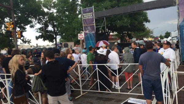 People are re-allowed to enter the main stage at Bohemian Nights at NewWestFest Sunday afternoon after a weather delay.
