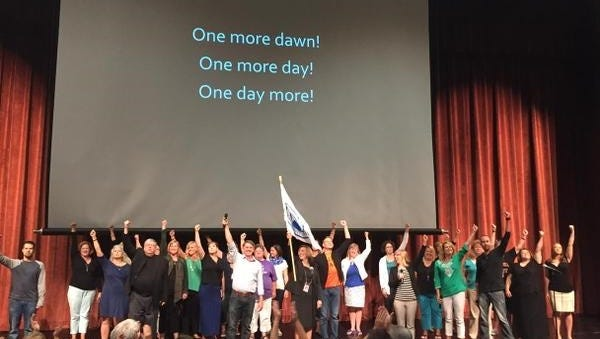 """West Des Moines teachers and staff surprised coworkers with a """"flash mob"""" song."""