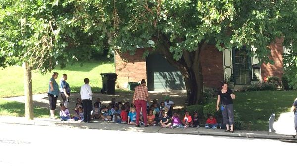 North Avondale Montessori students wait outside as authorities investigate a suspicious package at the school.