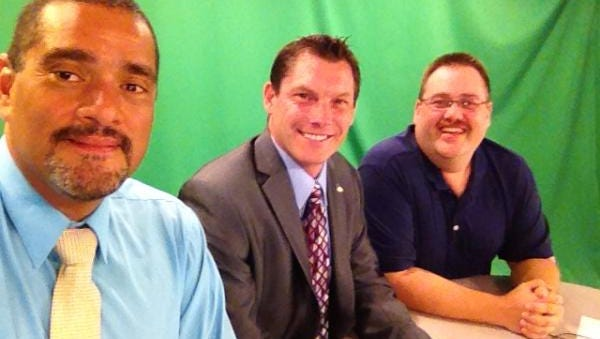 2014 Photo of columnist John A. Torres, football coach Steve Englehart (c) and sportswriter Mike Parsons, (r) on the set of FLORIDA TODAY studios.