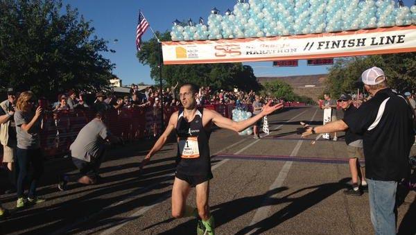 Aaron Metler crosses the finish line at the 2015 St. George Marathon.