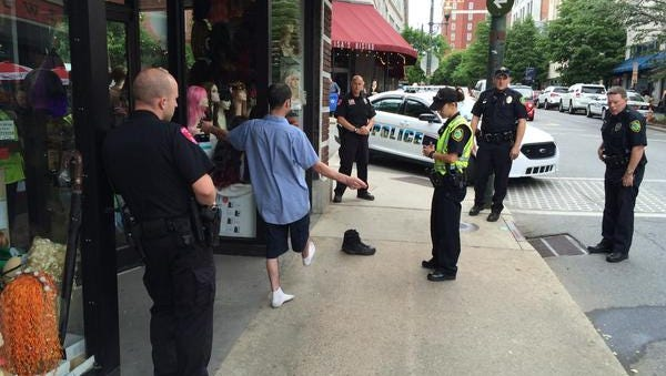Members of the Asheville-Buncombe DWI Task Force have a suspect take a sobriety test downtown in May.