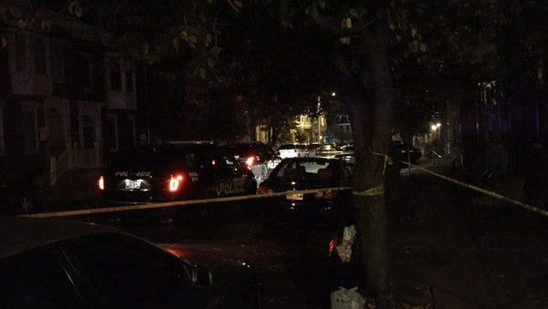 Police investigate a shooting in the 300 block of East King Street shortly after midnight on Saturday, Oct. 31, 2015.