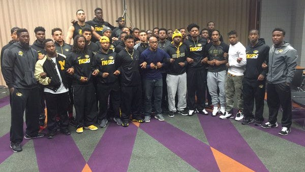Missouri football players announcing solidarity with students demanding resignation of university president.