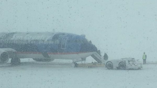 A plane sits on the tarmac at the Sioux Falls Regional Airport.