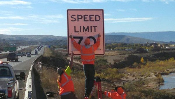 Crews install new speed limit signs along Interstate 15 through St. George on Tuesday, Nov. 24, 2015.