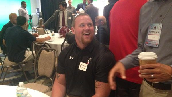UC left tackle Parker Ehinger, shown here at American Athletic Conference media day, has repeated as a first team All-AAC choice.