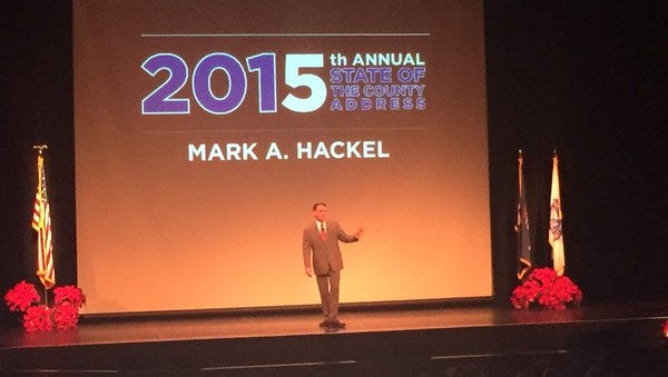 Macomb County Executive Mark Hackel on stage at his State of the County.